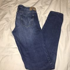 Hollister jeans: size 5 Long Lightly worn. Only tear in Hollister leather tag on back Hollister Jeans Skinny
