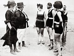 """Young women arrested on a Chicago bathing beach for wearing """"lewd"""" bathing suits, 1922"""