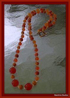 "23"" beaded necklace. Carnelian, orange topaz, porcelain & Swarovski crystals."