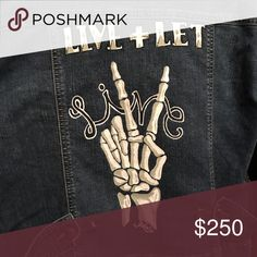 "Hand Painted Denim Jacket This is a denim jacket that I have hand painted. It features a skeleton hand making a peace sign and the quote ""LIVE AND LET LIVE"" Jackets & Coats Jean Jackets"
