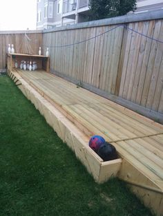 Garden Bowling with pull string pin pick up and ball return