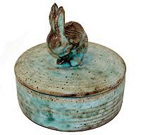 The rich earth tones of the Mississippi Delta are captured in the glazes and textures of this pottery, crafted with care by the Woods Brothers of Mound Bayou, MS. This piece measures 4 inches x 5 inches Mccarty Pottery, Ceramic Pottery, Ceramic Art, Ceramic Butter Dish, Rabbit Sculpture, Pottery Handbuilding, Some Bunny Loves You, Ceramic Boxes, Polish Pottery