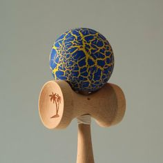 "Bahama Kendama Crackle - Blue over Gold by Bahama Kendama. $21.99. Bahama Kendama Standard Sized Kendama with a Crackle ""Sunburn"" Finish on the Ball. The colors are spectacular on these crackle painted kendamas! Feel the Burn!Specs:Weight: 5.0 ounces (145 g);Length from handle to tip: 6.375 inches."