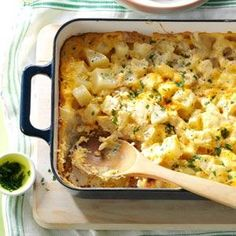 This Favorite Cheesy Potatoes Recipe has so many possibilities!  Make a couple to share at get-together's, enjoy it at brunches or pair it with a tasty ham dinner. | Recipe from Taste of Home