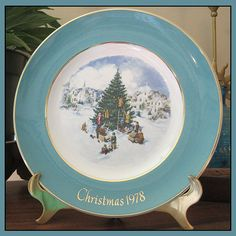 """This Avon Christmas plate is called """"Trimming the Tree"""" and is #6 in a series of 8 Christmas plates that began in 1973 and ended in 1980.  The plate is in excellent condition, No chips, cracks, repair"""