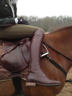 Brown boots + saddle and green/brown tartan breeches