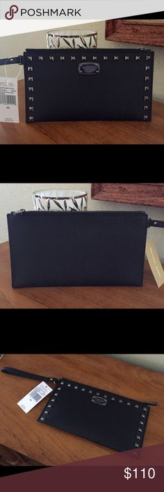"""Michael Kors Clutch. NWT Michael Kors new style Saffiano Studded leather zip clutch.  Beautiful and stylish!!!!  Wristlet strap can be folded flat against the back and used as a clutch. Interior offers a large multi function pocket and 6 card slots. 10"""" x 5.5"""".  NWT NO TRADES. Michael Kors Bags Clutches & Wristlets"""
