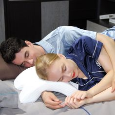 """""""Shaped like a tiny, foam-covered tunnel, the Coodle pillow is designed so the big spoon can cuddle in comfort— that person's arm goes underneath and through the domed tunnel, while the little spoon's head rests on top,"""" reports Simplemost. Spooning Pillow, Cuddle Pillow, Orthopedic Pillow, U Shaped Pillow, Big Spoon, Spinal Column, Side Sleeper Pillow, Foam Pillows, Silk Pillow"""