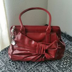 ..ELLE....GORGEOUS BOW SHAPE ... ....PURSE... GREAT CONDITION.... .....NORMAL WEAR ......NO FLAWS .....GORGEOUS  .....CRANBERRY CHERRY COLOR. .....opens up 2 ways.. ......bow on side  .... outside zipper compartment as well .....patent material feel... .....perfect for any night out event.. .....measurement. ...16x 12x 7x ......better in person Elle Bags