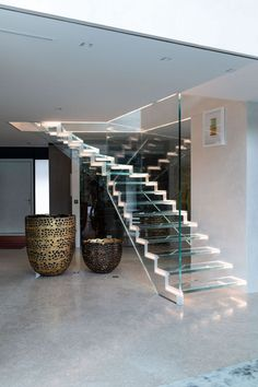 Glass stairs by Siller Walking On Glass, Glass Stairs, Corian, Staircase Design, Concrete, Minimalist, Steel, Landing, Wood