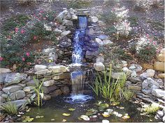 waterfall into a small pond.... wonder if that would work the way my wall is out there..... hmmm....