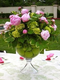 For the casual elegance of an afternoon lunch, I used the large vase and filled the base with green apples and arranged pink peonies (one of the most sensual flowers you can get) and green hydrangeas over top!