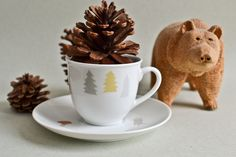 Cup and Saucer with deer, trees and a raccoon