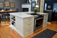 BKC Kitchen and Bath - Mid Continent Cabinetry, Pacifica door style, White paint on maple