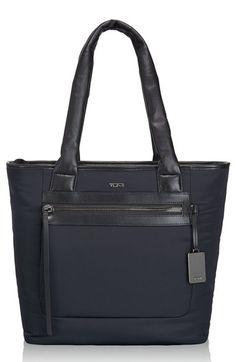 Free shipping and returns on Tumi 'Verona - Dylan' Nylon Tote at Nordstrom.com. Polished and refined, this spacious tote from the Verona Collection is made from lightweight, durable nylon and trimmed in smooth leather. The ingenious add-a-bag sleeve slips over extended luggage handles, allowing you to stack and carry the bag on your wheeled luggage as you navigate through busy airport terminals.