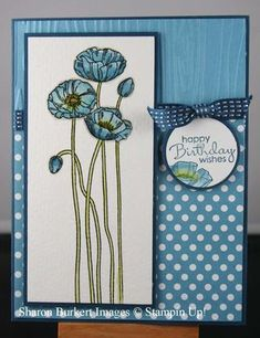 handmade card .... Pleasant Poppies and Marina Mist polka Dot parade ... like the match of the spindly stems and the textured embossed layer ... almost monochromatic blue ... lovely!!