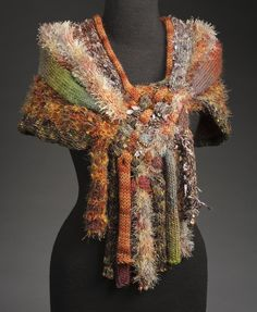 Th'Red Head Designs is owned by Marci Blank. She designs and creates one of a kind knitwear, both outerwear and accessories. Marci lives in Lenexa, Kansas, USA.