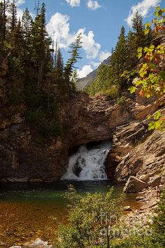 This is Running Eagle falls named after a female Native American warrior.  It is located in Glacier National Park in Montana.  It has also been called Trick Falls as in high water there is a falls over the top as well as in the middle.