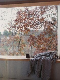 Window seating, large window, modern house, scandinavian interior design. Knut Hjeltnes House in Sandefjord, Norway