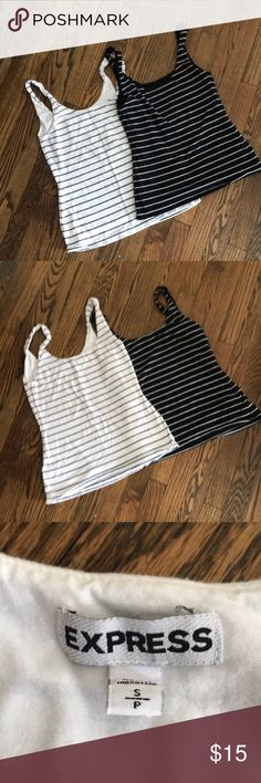 2 Express Stretch tank tops Black and white and white and black. These tank tops are amazing. Nice and thick with a solid liner inside. No rips, holes or stains. In great shape!  57% Cotton 38% Modal 5% Spandex Express Tops Tank Tops