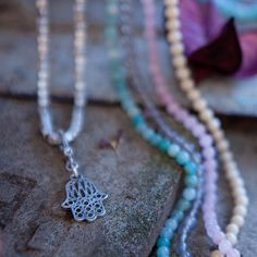 Hand charm necklace; Choose from this gorgeous selection of pastel stone shades or simple metal beads. Wear separately or layer for a chic look. Tutti & Co x