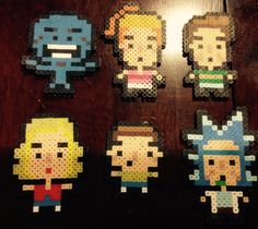 Some Rick and Morty perler bead key chains I made, the designs aren't mine, I found the refs online. No repins.