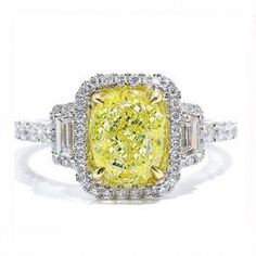 Emerald Cut Yellow Diamond Engagement Ring - A piece that will make her the envy of all her friends comes this beautiful Emerald Cut Yellow Diamond Engagement Ring stamped in 14k White Gold placed in an intricate setting. The lovely Canary Yellow Emerald cut diamond ring comes with a total gem weight of 1.72 carats along with an SI2 in clarity. All of the diamonds are 100% natural & are not heat treated. #unusualengagementrings