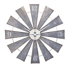 The IMAX Ward Metal Windmill Wall Clock. Like a clock whose hands are sweeping past the minutes of its face, this retro-inspired metal timekeeper will have you humming Dusty Springfield tunes in the wi D House, House Wall, Farm House, Cozy House, Home Wall Art, Wall Art Decor, Clock Decor, Windmill Clock, Windmill Decor