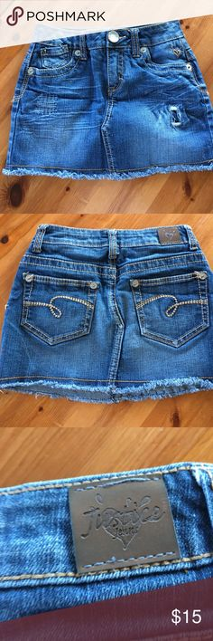 Girls Justice denim mini skirt Girls denim miniskirt from Justice.  Has sewn in attached shorts so just perfect for wearing!  Girls size 8 Justice Bottoms Skirts