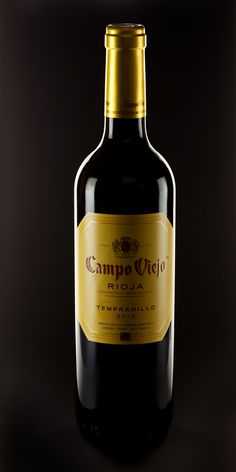 I like this picture because of the black background being used to contrast with the wine bottle.
