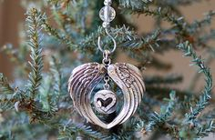 This beautiful Angel Wings Forever in My Heart Ornament will add a special…