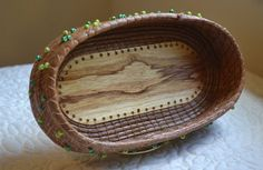 Oblong Pine Needle Basket with Poplar Bottom and Green Beads//$40.00 USD Overview Handmade item Materials: pine needles, beads, shellac, upholstery thread, green beads Feedback: 2 reviews Only ships to United States from Alabama, United States.