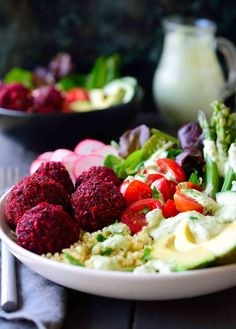 You'll get a whole, balanced and filling meal in just one dish with this baked beet falafel vegan quinoa bowl with horseradish dill sauce.