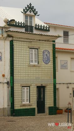 Tiled façade of a typical house in Ericeira, a  fishing village and popular seaside resort, 35 km northwest of Lisbon, considered one of the four World Surfing Reserves.