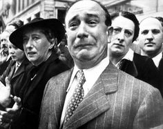French people staring and waving at the French Army remaining troops leaving France at Marseilles harbor,1940.