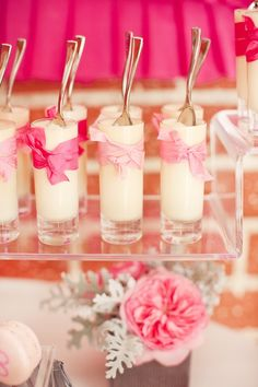If we have yogurt at the shower this could be an idea for a cute way to display it- ribbon wrapped shot glass desserts