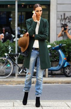 Nice and casual. Green Coat, Brown Hat, Hole'y denim, Black boots, Yellow Phone Ball.