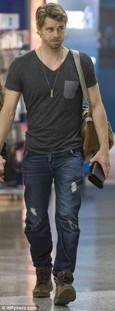 Casual Hollywood look: The actor sported a charcoal T-shirt teamed with ripped blue jeans ... http://dailym.ai/S3P84O#i-aab10e73