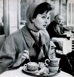 """""""At Munich's Cafe Luitpold, Ursula Thiess models coat and hat as flirtatious man behind her interferes with photographer's picture."""" """" LIFE Magazine - 1951 """""""