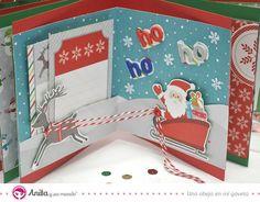 Manualidades navidad: mini álbum de fotos hecho con papel scrap de Navidad.