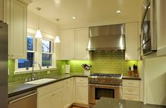 DEF wanna do green glass tiles like this with lighting under the cabinets. And this layout looks exactly like my kitchen except that the window is just a single not double like this one. I also wanna do a dark charcoal granite counter top, the cabinets will be white and we're going with Stainless Steel so it'll look a lot like this. I hope!