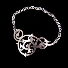 https://www.cityblis.com/7417/item/17180  Sterling Silver Thin Dainty Chain Bracelet with Ornate Floral Arabesque Detail - $94 by Skadi Jewellery Design !  Designed to complement the contours of the wrist and hand, this ornate silver chain bracelet flatters the wearer and makes a beautiful statement. It sits so comfortably without moving around that you'll forget you're even wearing it!  Handmade from 100% recycled Sterling Silver, this bracelet is d...
