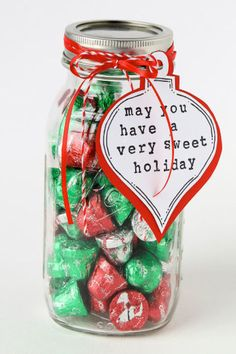 Sweet Treats- So what if you don't know exactly what's on your cousin's aunt's wish list? It's safe to assume everyone will enjoy a big jar of festive-colored chocolates. Click through to redbookmag.com to find more mason jar Christmas gifts.