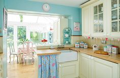 Best non-overbearing-Cath-Kidston motif so far. Turquoise wall + beige counters + hints of pink, blue and flowers all over...I like! :)