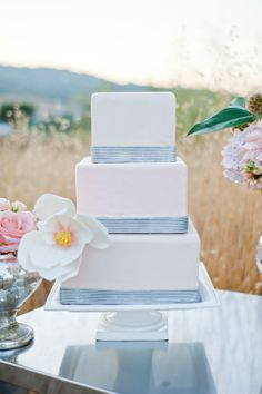 Square tiers with ribbon and a sugar magnolia