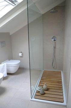 Glass shower wall, sunk-in floor even with rest of bathroom and walk-in, no door.Glass shower wall, sunk-in floor even with rest of bathroom and walk-in, no door. Attic Renovation, Attic Remodel, Attic Rooms, Wet Rooms, Attic Apartment, Apartment Therapy, Apartment Design, Loft Bathroom, Master Bathroom
