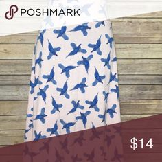 LuLaRoe Azure New with tags, cotton-like, printed LuLaRoe Azure skirt. No trades but open to reasonable offers! LuLaRoe Skirts