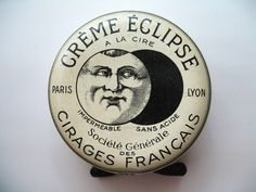 Creme Eclipse French shoe polish tin, early twentieth century. Diameter: 2 inches.