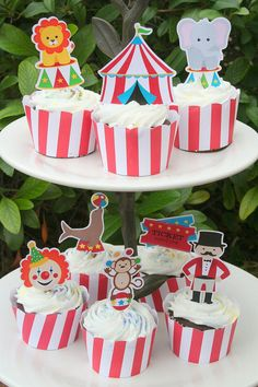 Assorted Circus or Carnival Cupcake Toppers This listing is for 12 totally adorable striped circus cupcake toppers! There are 12 different circus/carnival images, you will receive 1 of each (ringmaster, seal, circus tent, popcorn, circus girl, lion, tickets, elephant, bear, clown, cotton candy, and juggling monkey) unless otherwise specified. These toppers are all between 1.75-3tall. The picks used to create these cuties are non-toxic and food-safe. These cupcake toppers are handcrafted by