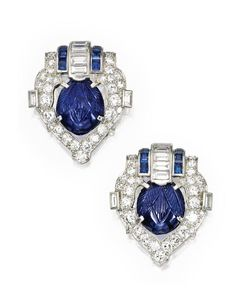 Pair of Platinum, Sapphire and Diamond Clip-Brooches, by Cartier, Circa 1925.